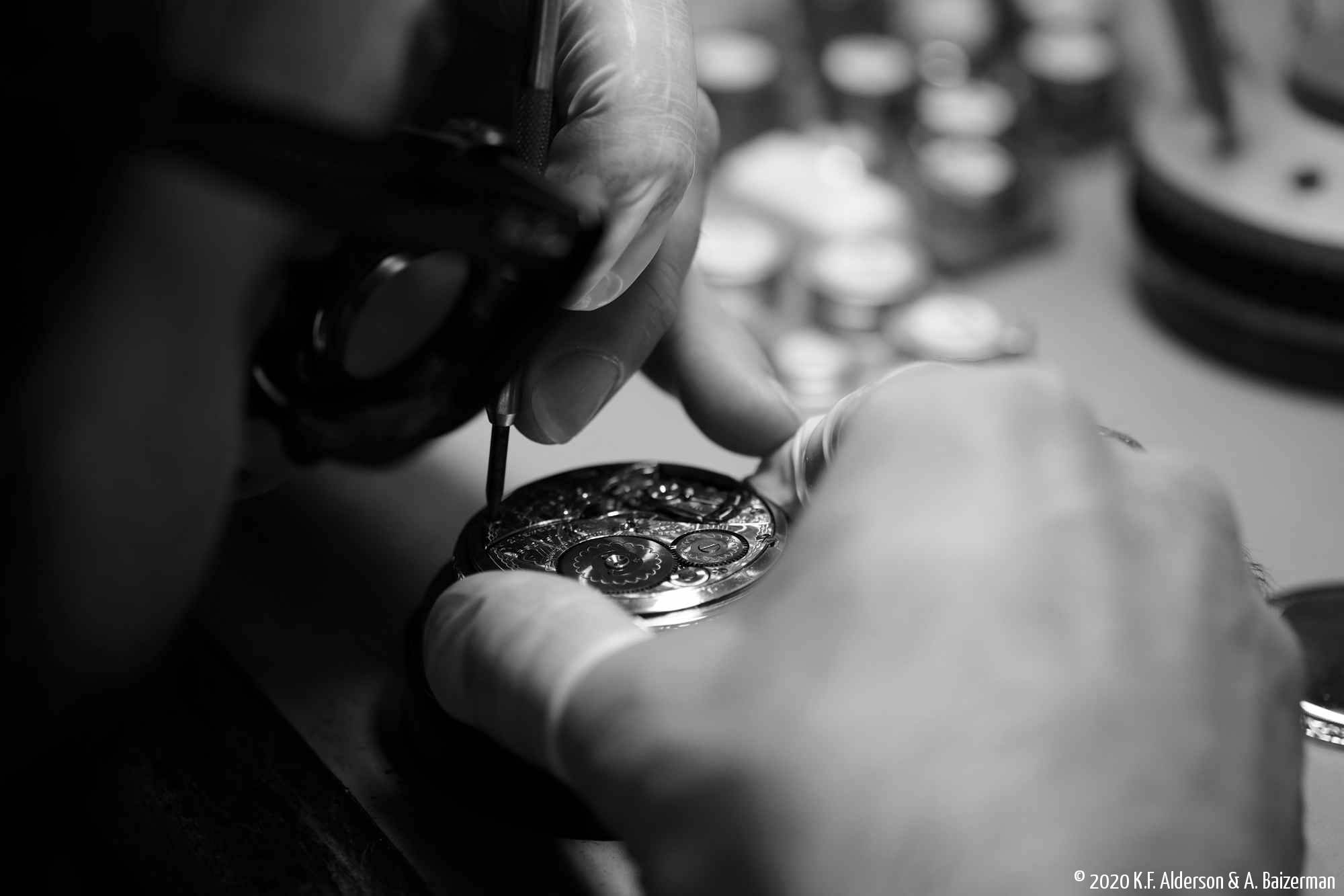 Watchmaker repairing antique pocket watch