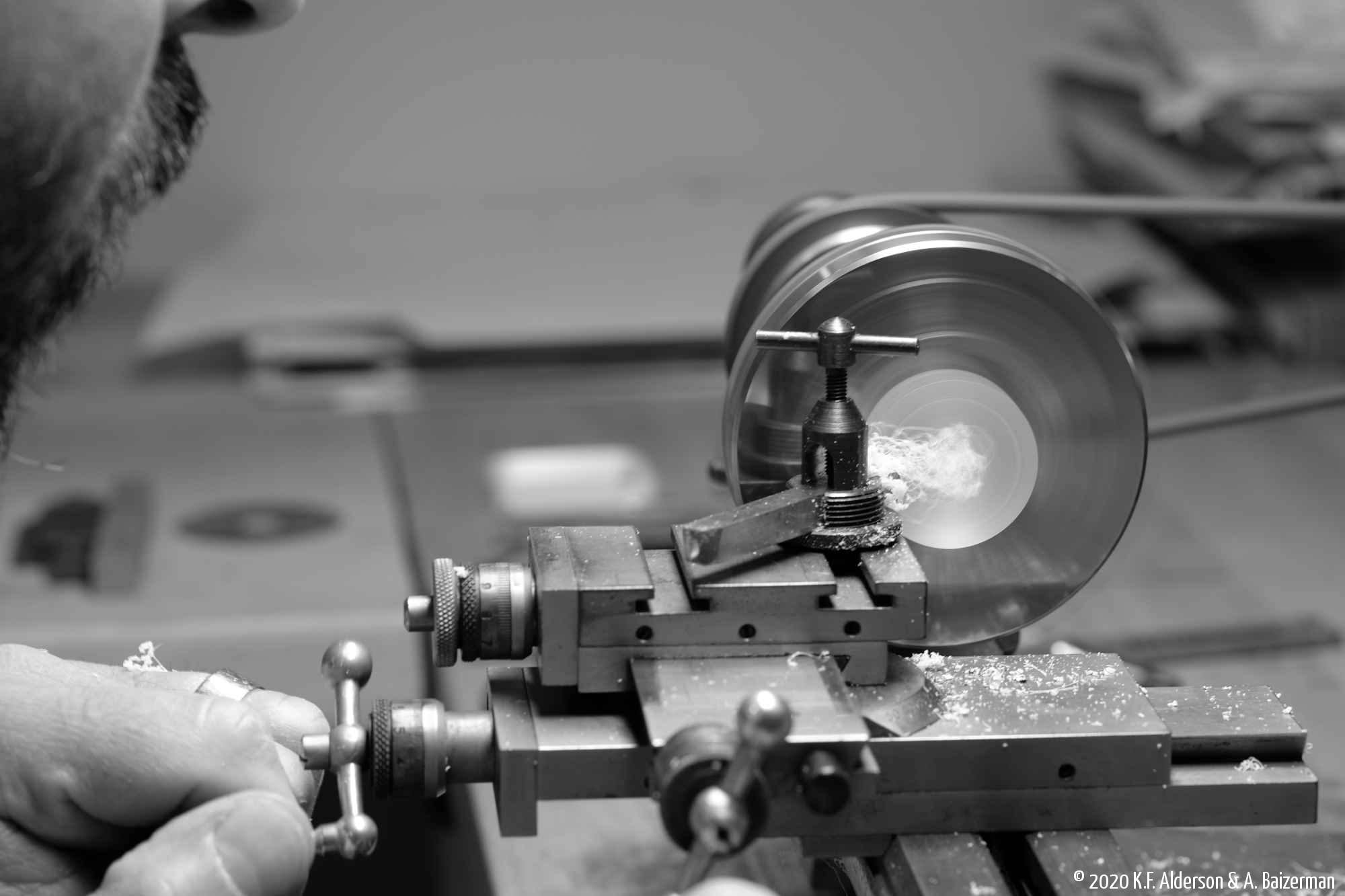 Watchmaker making part on lathe