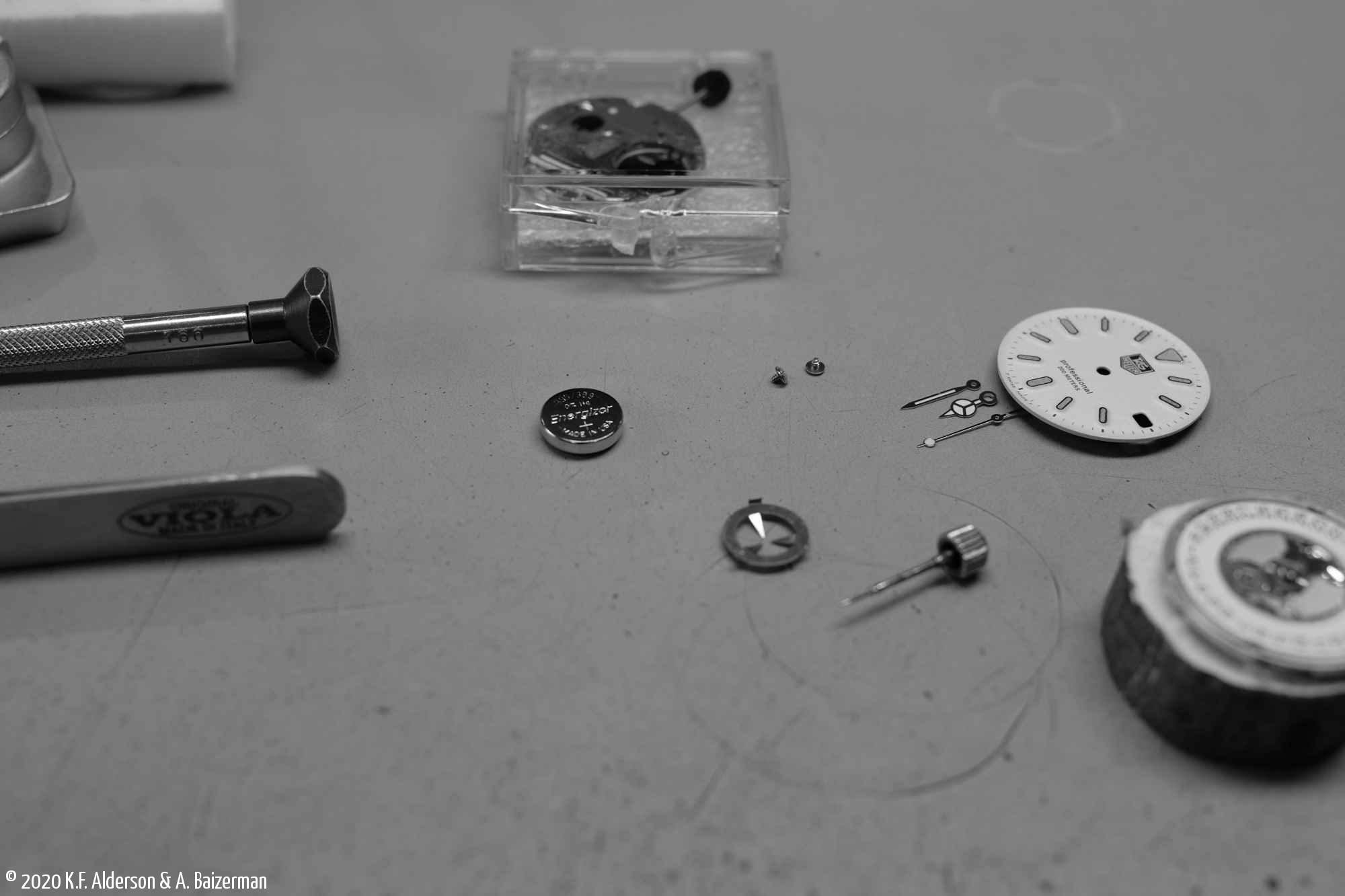 Quartz watch apart on workbench