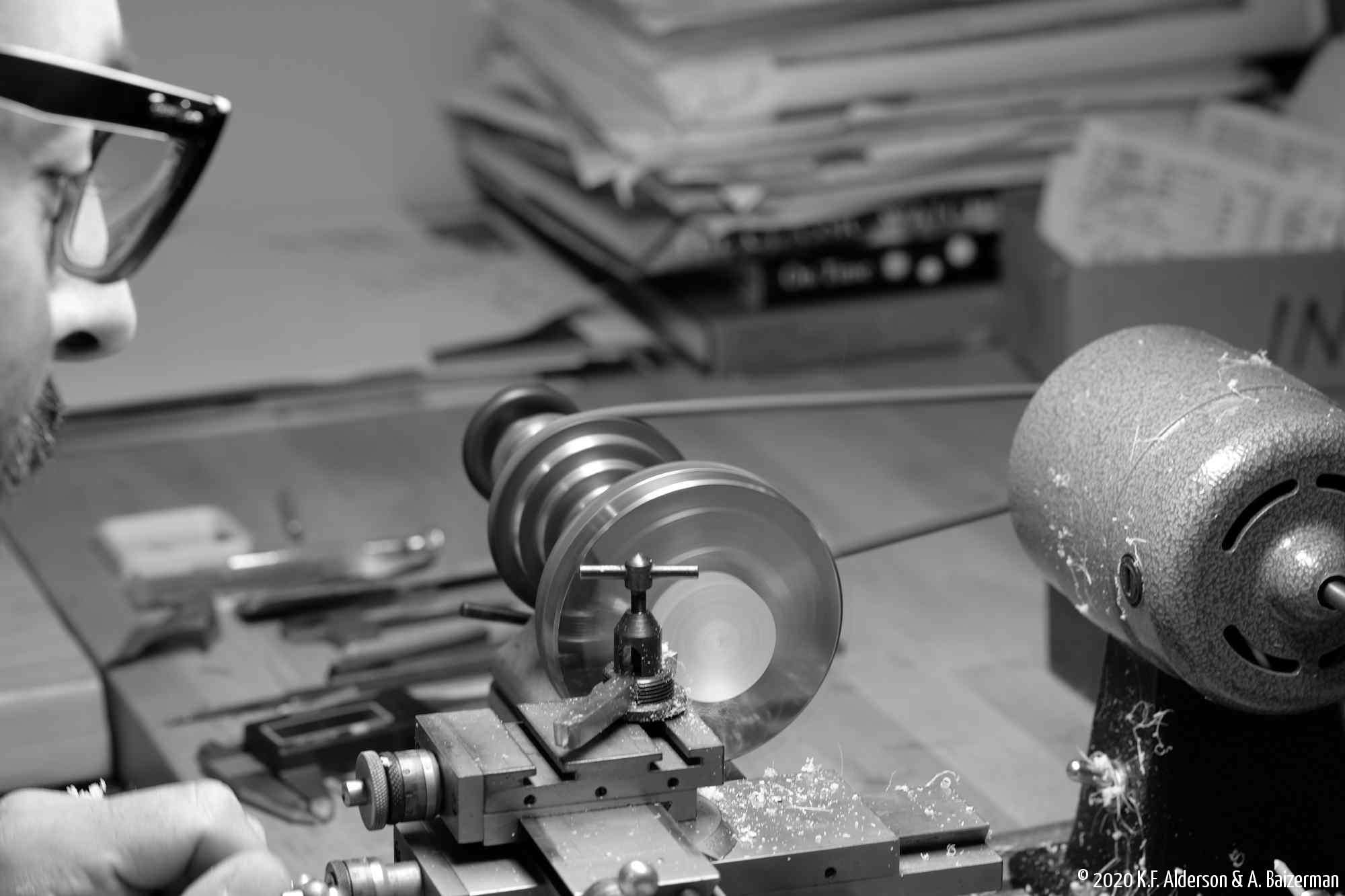 Watchmaker using lathe to make part